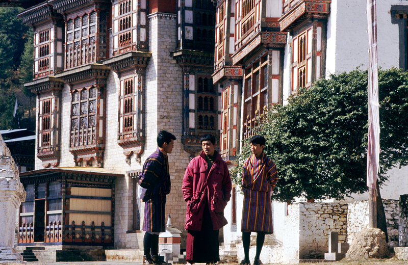 Monk with guests, Kurjey Lhakang, Bumthang